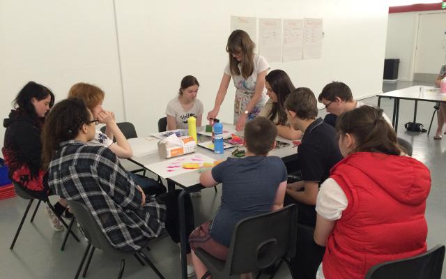 Graphic Designer Jennifer Leonard leads a design workshop with Salford's young carers