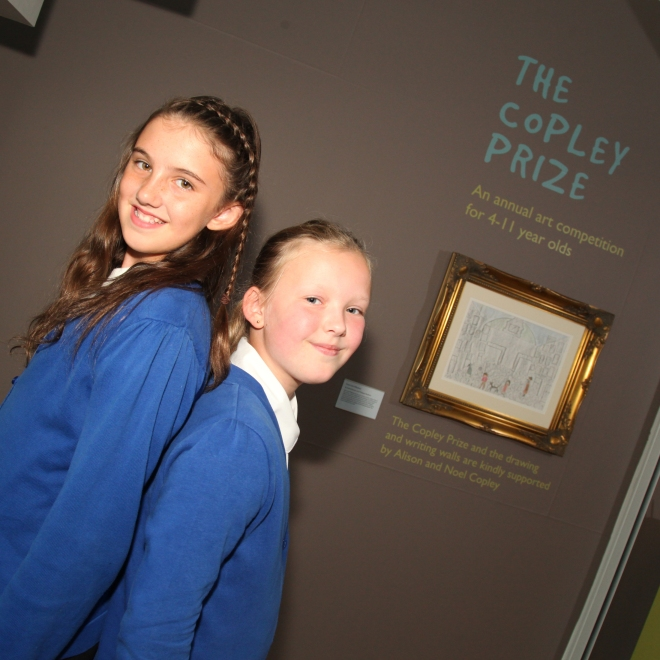 "1)Sasha Kuczer (Left) and Philippa Radicke with their winning artwork ""Down the Alleyway"" in The Lowry's gallery"
