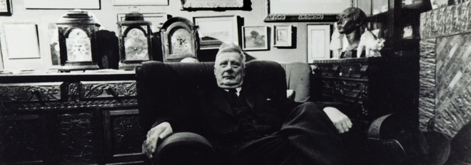 LS Lowry in his living room at The Elms. Photograph by Crispin Eurich © 'The First' Gallery, Southampton
